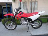 This is a 2014 Honda CRF 150 F. This bike is as near to