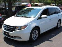 This outstanding example of a 2014 Honda Odyssey EX-L
