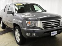 This outstanding example of a 2014 Honda Ridgeline RTL