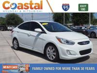 This 2014 Hyundai Accent GLS in White features: FWD