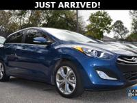 This Elantra GT features: Rear-View Camera, Navigation