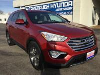 All smiles!!! This gas-saving 2014 Hyundai Santa Fe