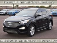 The certified pre-owned 2014 Hyundai Santa Fe Sport in