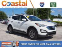 This 2014 Hyundai Santa Fe Sport 2.4L in Frost White