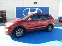 We are excited to offer this 2014 Hyundai Santa Fe