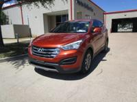 This outstanding example of a 2014 Hyundai Santa Fe