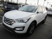 Cruise in complete comfort in this  2014 Hyundai Santa