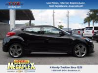 This 2014 Hyundai Veloster in Black is well equipped