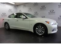 Look at this 2014 Infiniti Q50 . Its Automatic