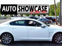 This 2014 Jaguar XF Supercharged features a 3.0L 24V V6