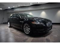This 2014 Jaguar XJ is offered in Ultimate Black with a