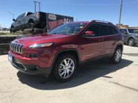Look at this 2014 Jeep Cherokee Limited. Its Automatic