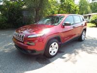 A 2014 Jeep Cherokee with EXTREMELY low miles (around