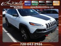 This outstanding example of a 2014 Jeep Cherokee
