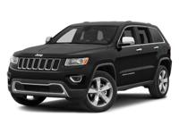 This outstanding example of a 2014 Jeep Grand Cherokee