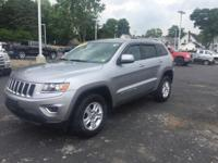 This 2014 Jeep Grand Cherokee Laredo in billet silver