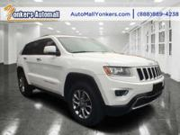 Solid and stately, this 2014 Jeep Grand Cherokee turns