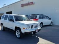 This outstanding example of a 2014 Jeep Patriot