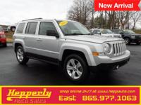 This 2014 Jeep Patriot Sport in Silver features. 28/23