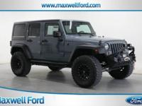 This 2014 Jeep Wrangler Unlimited Sport is offered to