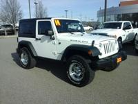 Looking for a clean, well-cared for 2014 Jeep Wrangler?