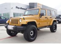 This BLACK 2014 Jeep Wrangler Unlimited 4D SUV 4WD