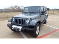 This 2014 Jeep Wrangler Unlimited Sahara is proudly