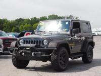 This 2014 Jeep Wrangler WILLYS WHEELER includes a hill
