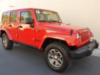 This is a 2014 Jeep Wrangler Unlimited Rubicon Luxury
