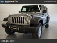 This 2014 Jeep Wrangler Unlimited Willys Wheeler is