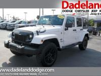 This 2014 Jeep Wrangler Unlimited Freedom Edition is