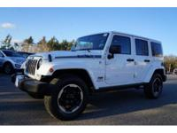Clean CARFAX. White 2014 Jeep Wrangler Unlimited Sahara