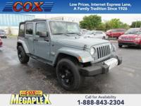 This 2014 Jeep Wrangler Unlimited Sahara in Anvil Clear