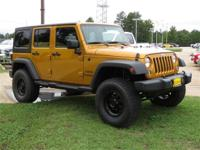Clean CARFAX. Gold 2014 Jeep Wrangler Unlimited Sport