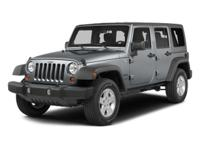 This 2014 Jeep Wrangler Unlimited Sport is proudly