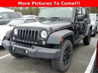 This 2014 Jeep Wrangler Unlimited Sport is loaded with