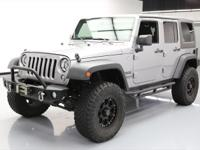 This awesome 2014 Jeep Wrangler 4x4 comes loaded with