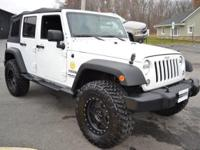 This 2014 Jeep Wrangler Unlimited 4dr Unlimited Sport