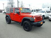 This outstanding example of a 2014 Jeep Wrangler