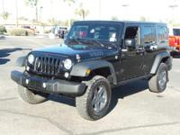 This 2014 Jeep Wrangler Unlimited Willys Wheeler will