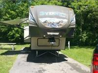 This Keystone Outback is new like new condition, has