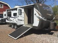 2014 Keystone Outback SuperLite 230RS Travel Trailer.