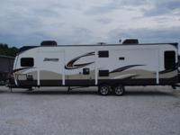 This 2014 RV is a 35 foot long Keystone Sprinter Model