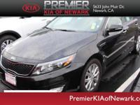 This 2014 Kia Optima LX is proudly offered by Premier