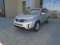 This outstanding example of a 2014 Kia Sorento LX is