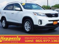 This 2014 Kia Sorento LX in Snow White Pearl features.