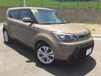 2014 Kia Soul Plus. Low miles indicate the vehicle is