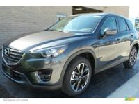 CX-5 Grand Touring trim, METEOR GRAY MICA exterior and