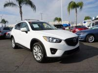 Buckle up for the ride of a lifetime! This 2014 Mazda