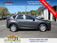 This 2014 Mazda CX-5 Sport in Meteor Gray Mica is well
